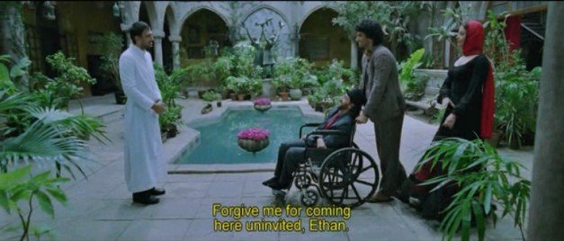 Ethan meets a priest friend in front of one of the pools on his property