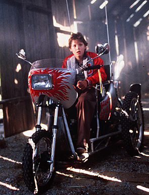Corey Haim as Marty riding the Silver Bullet
